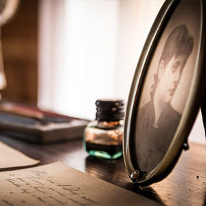 written letter with ink and picture frame