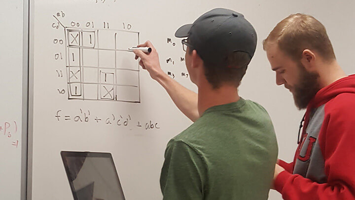 Math & Stats Center tutor helps a student