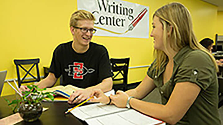 The Writing Center tutor helps a student