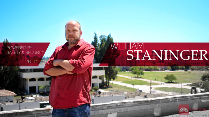 william bill staninger arms crossed on rooftop