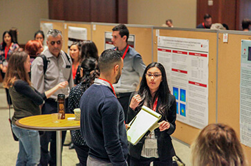 Multiple poster presentations in progress at the 2020 Student Research Symposium
