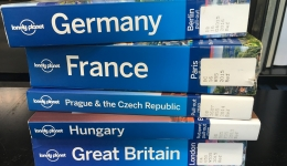 stack of travel guides