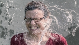 woman splashed in face with water