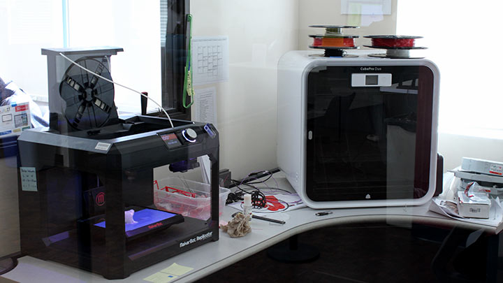 2 3d printers on a table