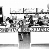 First graders staffing & using a supermarket mockup