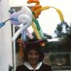 balloon animals on graduation cap