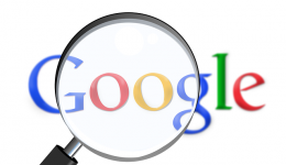 Google Logo with Magnifying glass over it