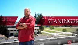 william bill staninger security coordinator arms crossed on rooftop