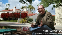 wil weston smiling outdoors on bench at sdsu
