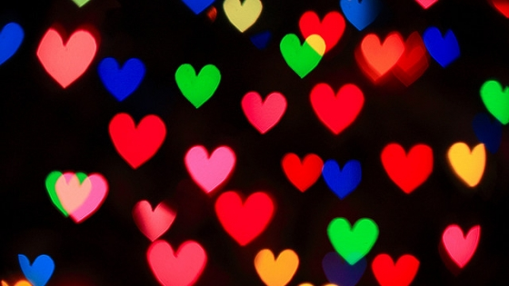 blackbackground with multi colored hearts